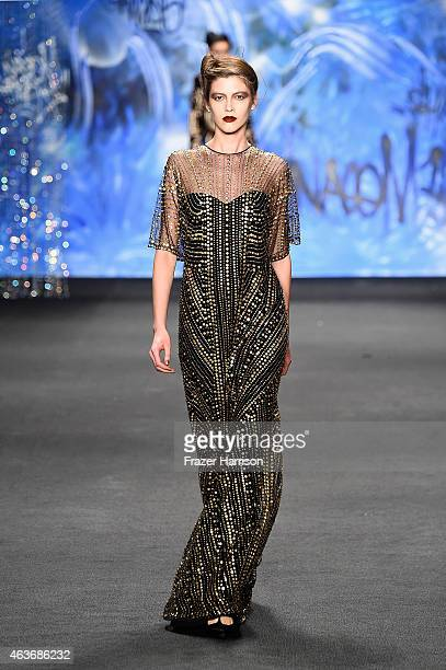 A model walks the runway at the Naeem Khan fashion show during MercedesBenz Fashion Week Fall 2015 at The Theatre at Lincoln Center on February 17...
