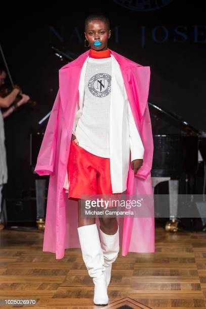 A model walks the runway at the Naim Josefi show during Stockholm Runway SS19 at Grand Hotel on August 29 2018 in Stockholm Sweden