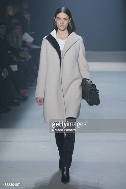 A model walks the runway at the Narciso Rodriguez Fall 2014 fashion show during New York Fashion Week at SIR Stage37 on February 11 2014 in New York...