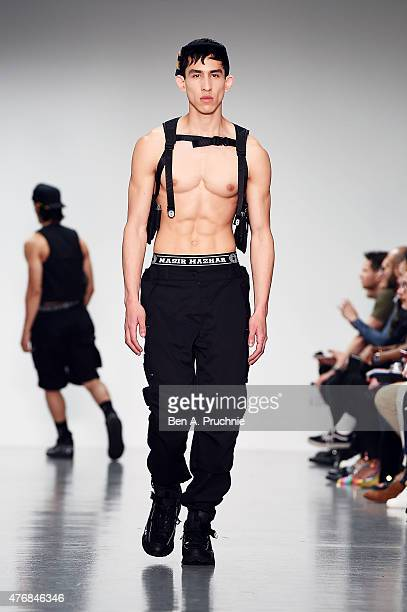 A model walks the runway at the Nasir Mazhar show during The London Collections Men SS16 at Victoria House on June 12 2015 in London England