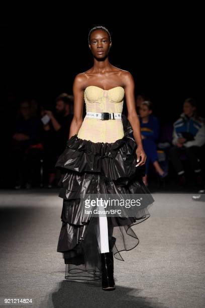 Model walks the runway at the Natasha Zinko show during London Fashion Week February 2018 at The Queen Elizabeth II Conference Centre on February 20,...