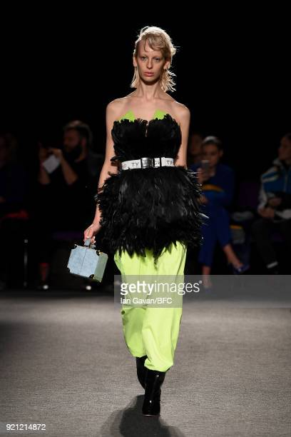 A model walks the runway at the Natasha Zinko show during London Fashion Week February 2018 at The Queen Elizabeth II Conference Centre on February...