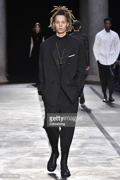 A model walks the runway at the Neil Barrett Autumn Winter 2017 fashion show during Milan Menswear Fashion Week on January 14 2017 in Milan Italy