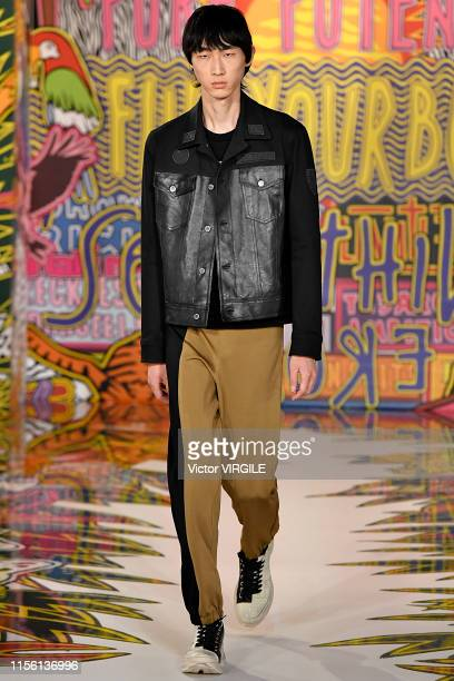A model walks the runway at the Neil Barrett fashion show during the Milan Men's Fashion Week Spring/Summer 2020 on June 15 2019 in Milan Italy