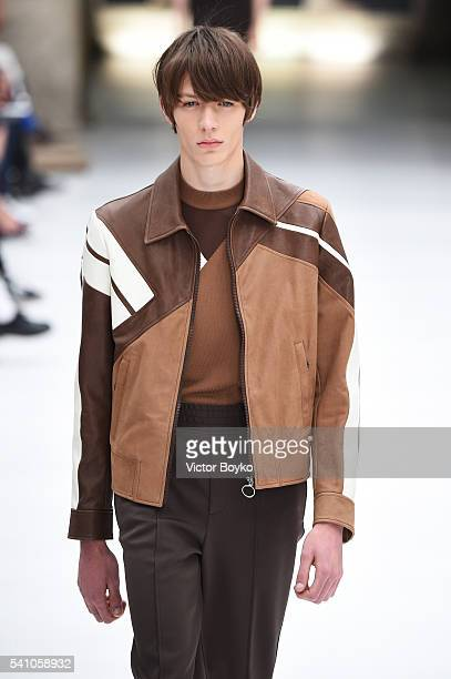 A model walks the runway at the Neil Barrett show during Milan Men's Fashion Week Spring/Summer 2017 on June 18 2016 in Milan Italy
