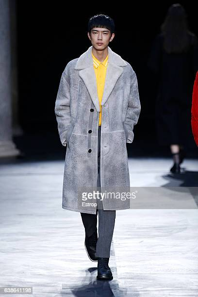 A model walks the runway at the Neil Barrett show during Milan Men's Fashion Week Fall/Winter 2017/18 on January 14 2017 in Milan Italy
