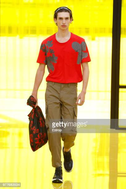 A model walks the runway at the Neil Barrett show during Milan Men's Fashion Week Spring/Summer 2019 on June 16 2018 in Milan Italy
