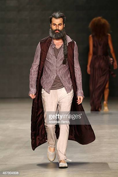 A model walks the runway at the Nej show during Mercedes Benz Fashion Week Istanbul SS15 at Antrepo 3 on October 16 2014 in Istanbul Turkey