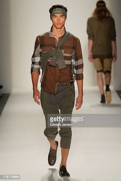 A model walks the runway at the Nicholas K show during Spring 2014 MercedesBenz Fashion Week at The Studio at Lincoln Center on September 5 2013 in...