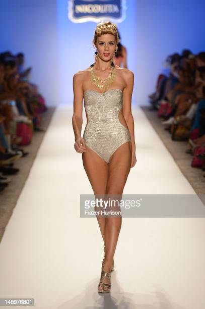 A model walks the runway at the Nicolita show during MercedesBenz Fashion Week Swim 2013 at The Raleigh on July 20 2012 in Miami Beach Florida