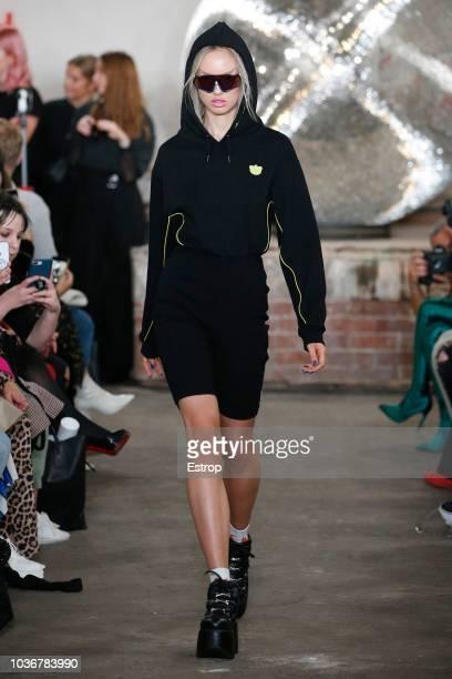 Model walks the runway at the Nicopanda show during London Fashion Week September 2018 on September 14, 2018 in London, England.