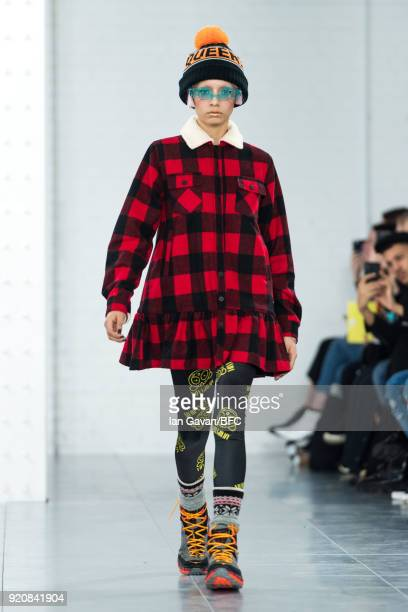 Model walks the runway at the Nicopanda show during London Fashion Week February 2018 at TopShop Show Space on February 19, 2018 in London, England.