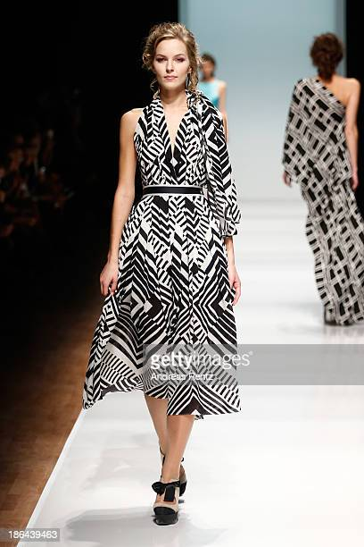 A model walks the runway at the Nikolai Kyvyrzhik by SLAVA ZAITSEV during MercedesBenz Fashion Week Russia S/S 2014 on October 31 2013 in Moscow...