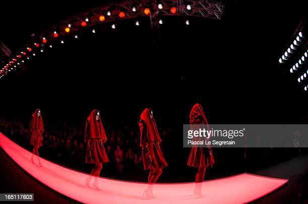 A Model walks the runway at the Nikolai Kyvyrzhik by Slava Zaitsev show during MercedesBenz Fashion Week Russia Fall/Winter 2013/2014 at Manege on...