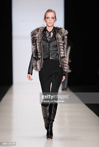 A model walks the runway at the Nikolay Krasnikov show during MercedesBenz Fashion Week Russia Fall/Winter 2013/2014 at Manege on March 31 2013 in...