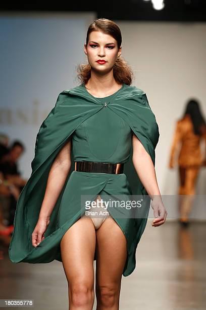 A model walks the runway at the Nina Athanasiou show during Nolcha Fashion Week New York Spring/Summer 2014 presented by RUSK at Pier 59 Studios on...