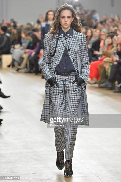 A model walks the runway at the Nina Ricci Autumn Winter 2017 fashion show during Paris Fashion Week on March 4 2017 in Paris France