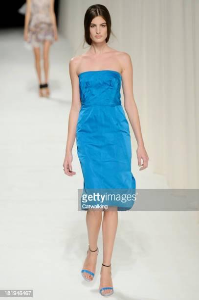 A model walks the runway at the Nina Ricci Spring Summer 2014 fashion show during Paris Fashion Week on September 26 2013 in Paris France