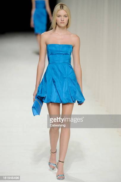 A model walks the runway at the Nina Ricci Spring Summer 2014 fashion show during Paris Fashion Week on September 26 2013 in Paris France