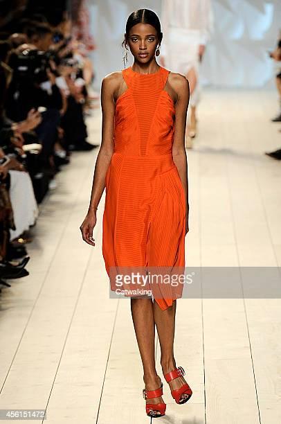 A model walks the runway at the Nina Ricci Spring Summer 2015 fashion show during Paris Fashion Week on September 25 2014 in Paris France