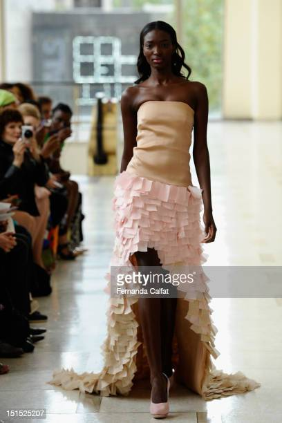 A model walks the runway at the Nina Skarra Spring 2013 fashion show during MercedesBenz Fashion Week at Avery Fisher Hall Lincoln Center on...