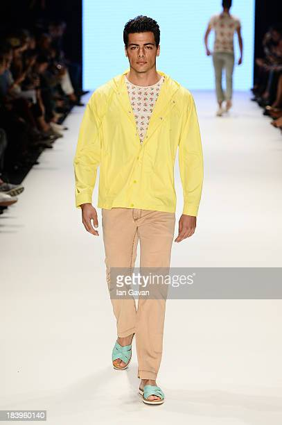 A model walks the runway at the Niyazi Erdogan show during MercedesBenz Fashion Week Istanbul s/s 2014 Presented By American Express on October 10...