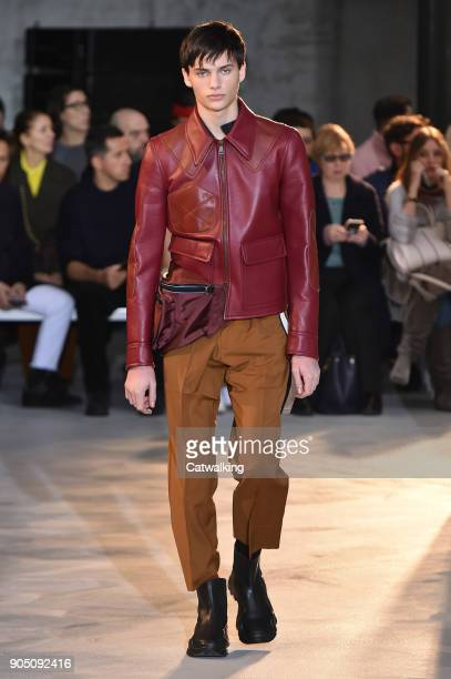 A model walks the runway at the No21 Armani Autumn Winter 2018 fashion show during Milan Menswear Fashion Week on January 15 2018 in Milan Italy