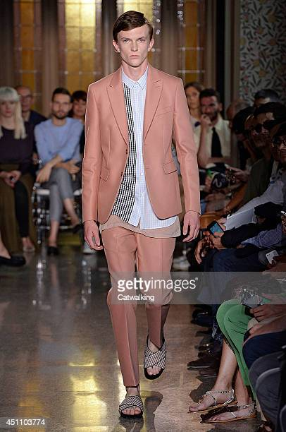 A model walks the runway at the No21 Spring Summer 2015 fashion show during Milan Menswear Fashion Week on June 23 2014 in Milan Italy