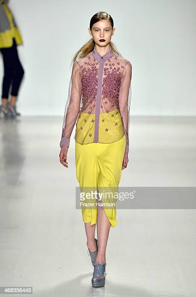 A model walks the runway at the Noon By Noor fashion show during MercedesBenz Fashion Week Fall 2014 at The Salon at Lincoln Center on February 10...