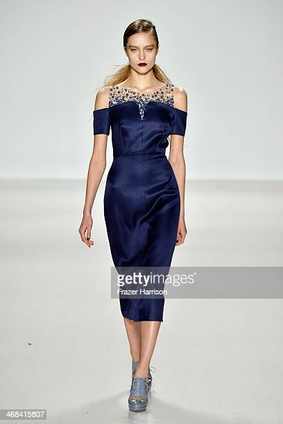 A model walks the runway at the Noon By Noor fashion show during MercedesBenz Fashion Week Fall 2014 at Lincoln Center on February 10 2014 in New...