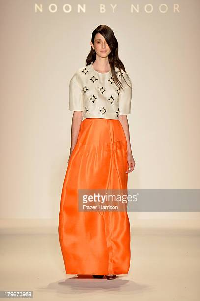 A model walks the runway at the Noon By Noor Spring 2014 fashion show during MercedesBenz Fashion Week at The Studio at Lincoln Center on September 6...