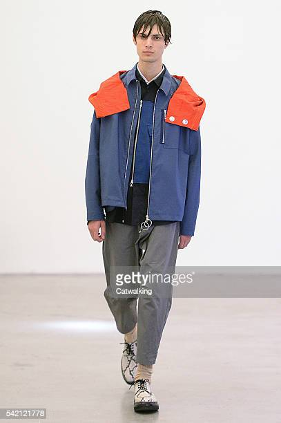 A model walks the runway at the OAMC Spring Summer 2017 fashion show during Paris Menswear Fashion Week on June 22 2016 in Paris France