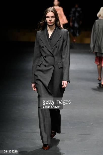 A model walks the runway at the Odeeh Defile during the Berlin Fashion Week Autumn/Winter 2019 at Haus Der Berliner Festspiele on January 14 2019 in...