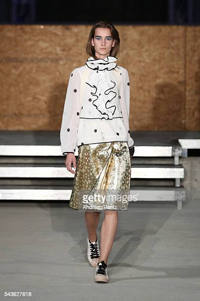 A model walks the runway at the Odeeh defilee during the Der Berliner Mode Salon Spring/Summer 2017 at Berliner Schloss city palace on June 28 2016...