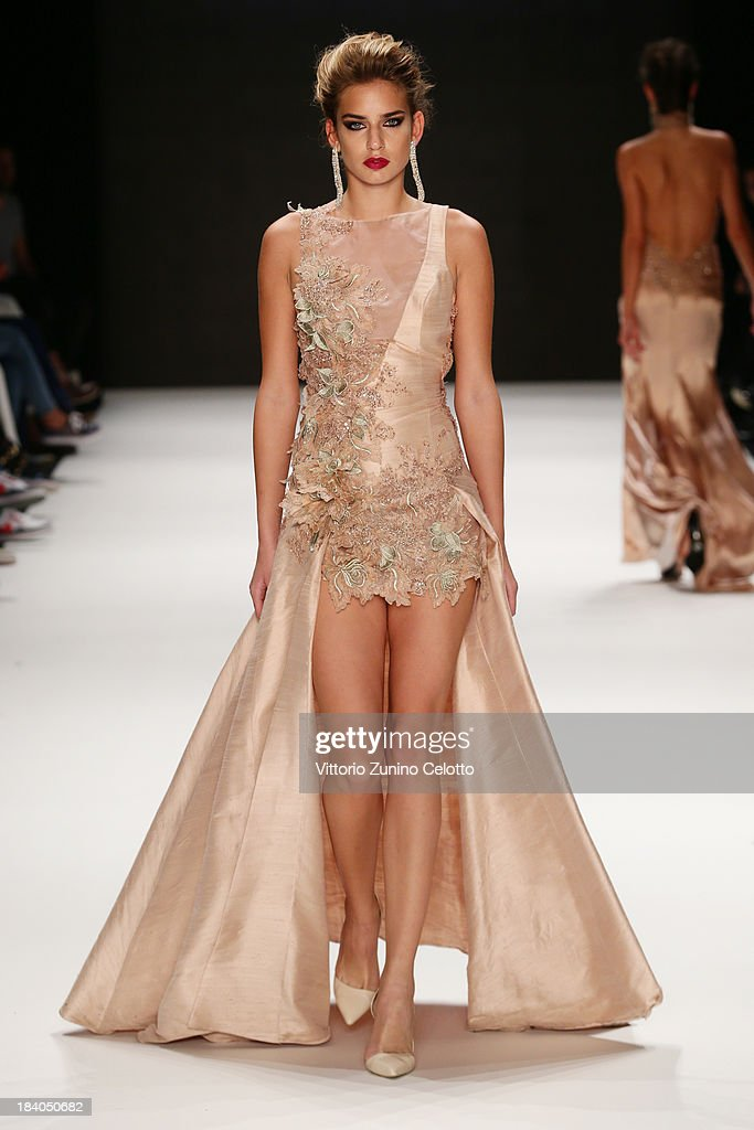 A model walks the runway at the Odrella show during Mercedes-Benz Fashion Week Istanbul s/s 2014 Presented By American Express on October 11, 2013 in Istanbul, Turkey.