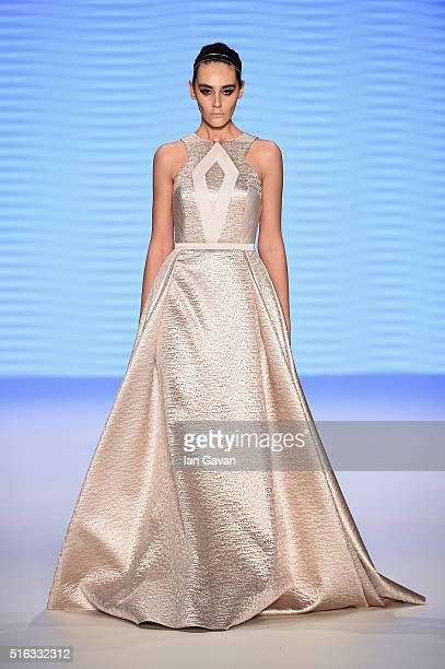 A model walks the runway at the Oezlem Erkan show during the MercedesBenz Fashion Week Istanbul Autumn/Winter 2016 at Zorlu Center on March 18 2016...