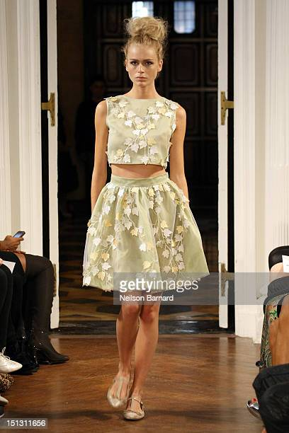 A model walks the runway at the Olcay Gulsen spring 2013 fashion show during MercedesBenz Fashion Week at Academy Mansion on September 5 2012 in New...