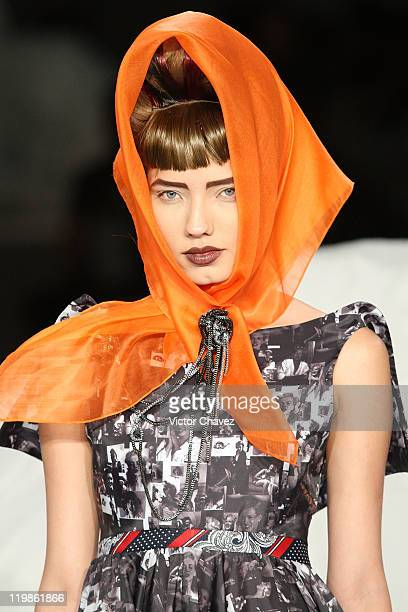 A model walks the runway at the Olga Piedrahita fashion show during Colombiamoda 2011 day one at Antigua Bodega Coltejer on July 25 2011 in Medellin...