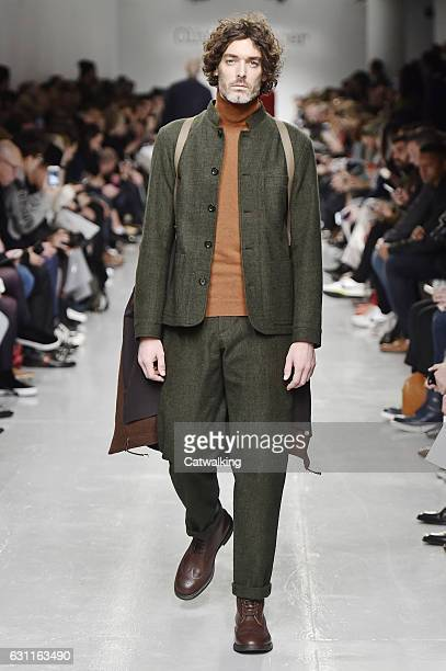 Model walks the runway at the Oliver Spencer Autumn Winter 2017 fashion show during London Menswear Fashion Week on January 7, 2017 in London, United...