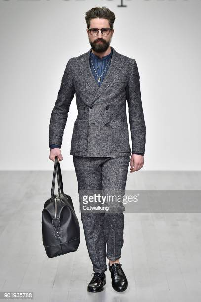 A model walks the runway at the Oliver Spencer Autumn Winter 2018 fashion show during London Menswear Fashion Week on January 6 2018 in London United...