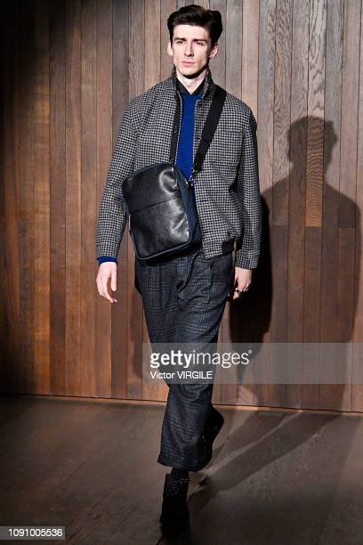 Model walks the runway at the Oliver Spencer Fall/Winter 2019-2020 fashion show during London Fashion Week Men's January 2019 at the Royal Academy of...