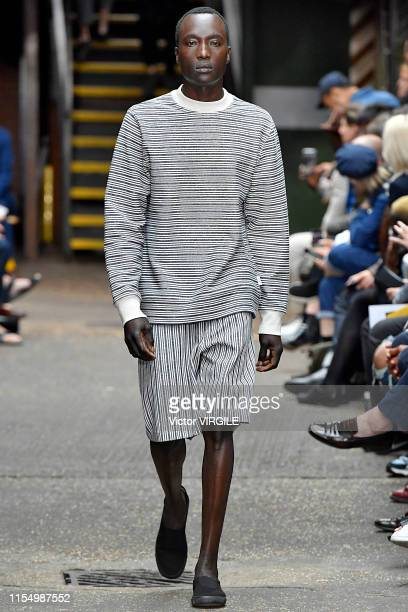 Model walks the runway at the Oliver Spencer Ready to Wear Spring/Summer 2020 fashion show during London Fashion Week Men's June 2019 on June 09,...