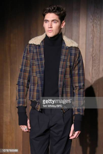 A model walks the runway at the Oliver Spencer show during London Fashion Week Men's January 2019 at the Royal Academy of Arts on January 7 2019 in...