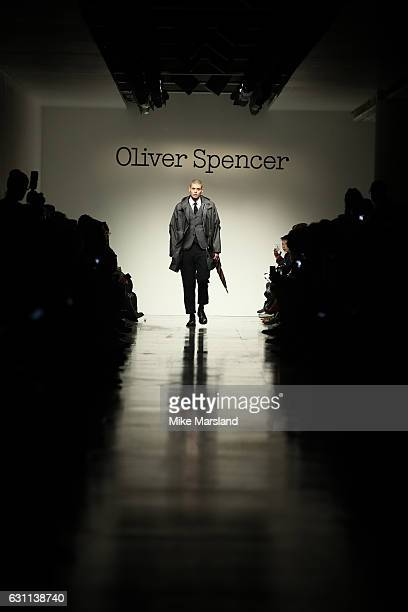 A model walks the runway at the Oliver Spencer show during London Fashion Week Men's January 2017 collections at BFC Show Space on January 7 2017 in...