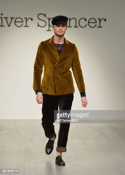 Model walks the runway at the Oliver Spencer show during London Fashion Week Men's January 2018 at BFC Show Space on January 6, 2018 in London,...