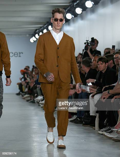 A model walks the runway at the Oliver Spencer show during The London Collections Men SS17 at BFC Show Space on June 10 2016 in London England