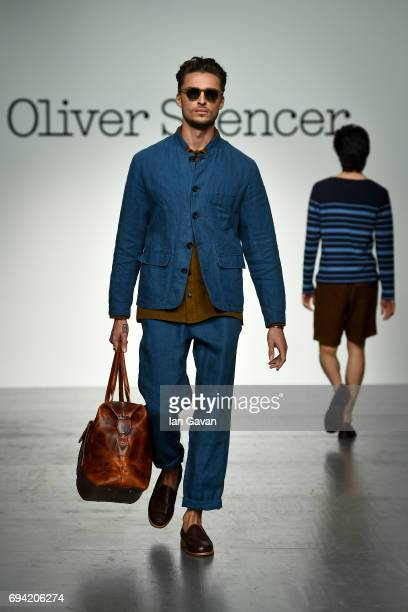 A model walks the runway at the Oliver Spencer show during the London Fashion Week Men's June 2017 collections on June 9 2017 in London England