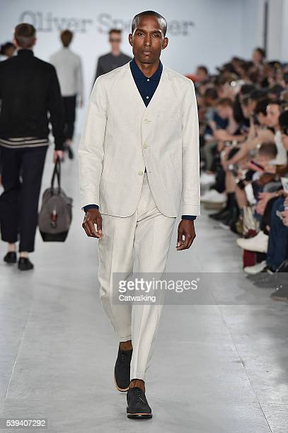 A model walks the runway at the Oliver Spencer Spring Summer 2017 fashion show during London Menswear Fashion Week on June 10 2016 in London United...