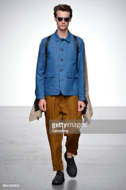 A model walks the runway at the Oliver Spencer Spring Summer 2018 fashion show during London Menswear Fashion Week on June 9 2017 in London United...