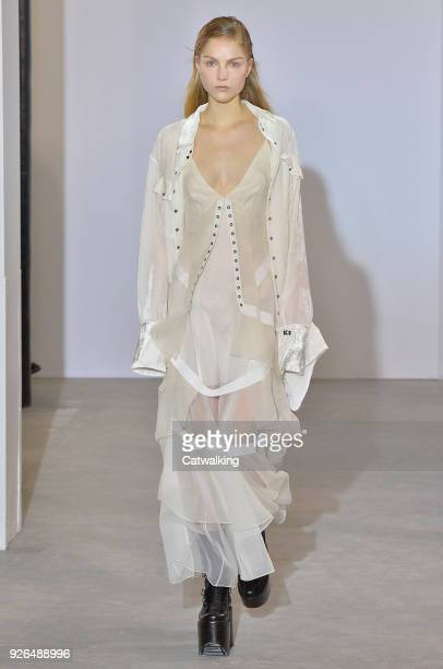 Model walks the runway at the Olivier Theyskens Autumn Winter 2018 fashion show during Paris Fashion Week on March 2, 2018 in Paris, France.
